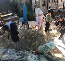 Sandpit group digging and play May 21