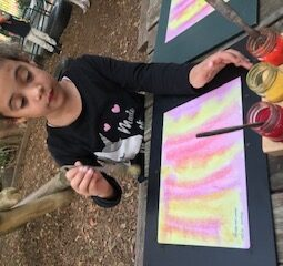 Alana painting wet water with Y. P. R