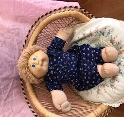 Doll Cabbage sitting on chair